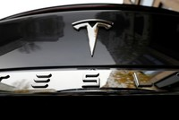 Tesla value hits $100 billion, overtaking Volkswagen