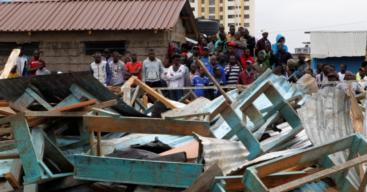 Kenyan people gather at the site of a collapsed school classroom, in Nairobi, Kenya, Sept. 23, 2019. (Reuters Photo)