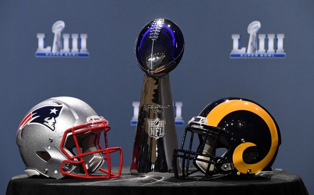 The Vince Lombardi Trophy and helmets for the New England Patriots and Los Angeles Rams are displayed before the Roger Goodell press conference in advance of Super Bowl LIII at Georgia World Congress Center. (Reuters Photo)