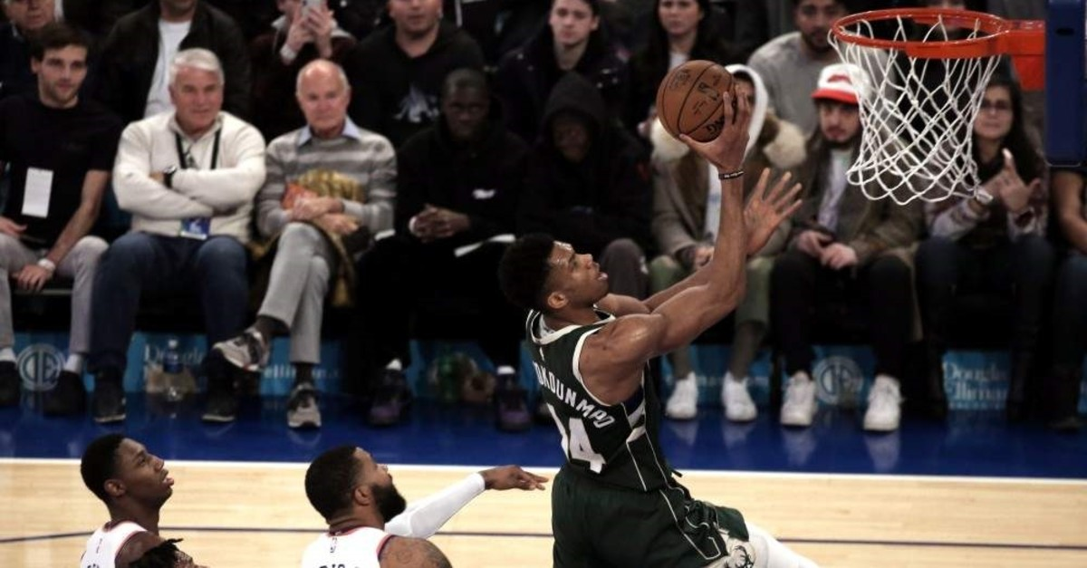 Bucks forward Giannis shoots over three Knicks defenders in the first half in New York, Dec. 21, 2019. (EPA Photo)