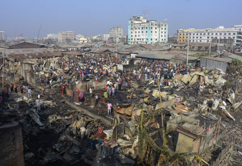 Houses destroyed by fire are seen in a slum in Chittagong, Bangladesh, Sunday, Feb. 17, 2019. (AFP Photo)