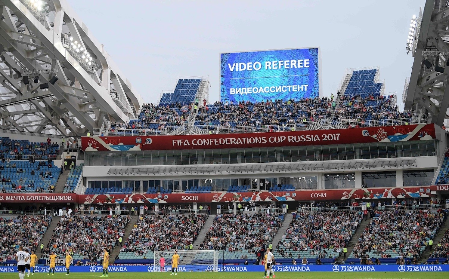Players wait for a decision on a goal by video assistant referees during the Confederations Cup group B football match between Australia and Germany at the Fisht Stadium in Sochi on June 19, 2017.