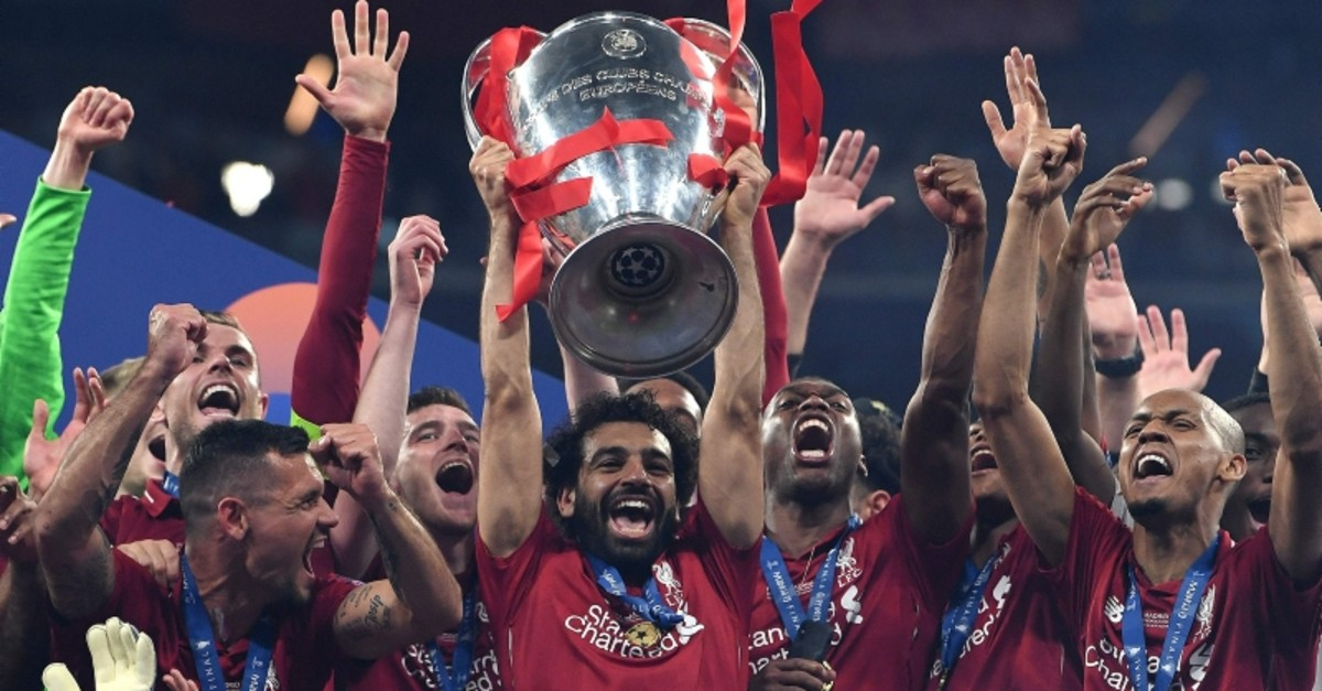 - Liverpool's Egyptian forward Mohamed Salah (C) raises the European Champion Clubs' Cup as he celebrates with teammates winning the UEFA Champions League final football match between Liverpool and Tottenham (AFP Photo)