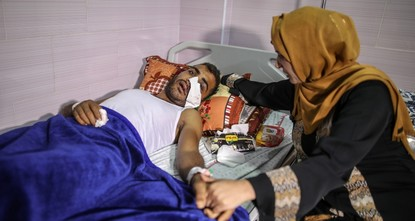 Palestinian hit by gas canister hopes for treatment outside Gaza