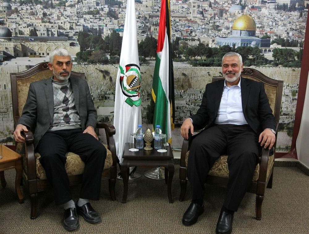 Gaza's senior Hamas leader Ismail Haniya (R) meets with freed Palestinian prisoner Yahya Sinwar (L), in Gaza City on Feb. 21.