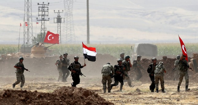 Turkish and Iraqi soldiers wave their countries' national flags during a military exercise near the Turkish-Iraqi border in the Silopi district, Şırnak, Turkey, Sept. 26.