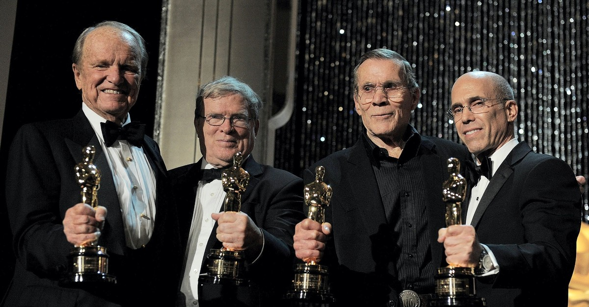 Award recipients George Stevens Jr. (L) and D.A. Pennebaker (C-L) pose with their Oscars in Los Angeles in 2012.