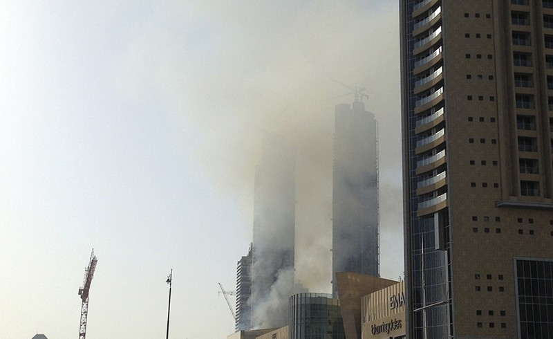 Smoke rises from a fire at a construction site near Dubai Mall in Dubai, United Arab Emirates, Sunday, April 2, 2017 (AP Photo)
