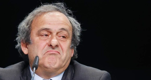 FILE - in This May 28, 2015 file photo Michel Platini grimaces during a press conference following a meeting of the UEFA board, Zurich, May 28, 2015. AP Photo