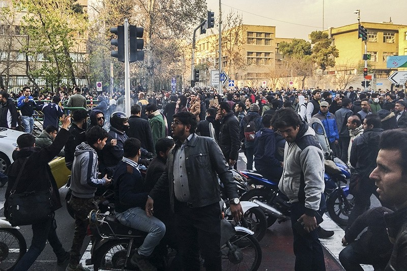 In this photo taken by an individual not employed by the Associated Press and obtained by the AP outside Iran, demonstrators gather to protest against Iran's weak economy, in Tehran, Iran, Saturday, Dec. 30, 2017. (AP Photo)