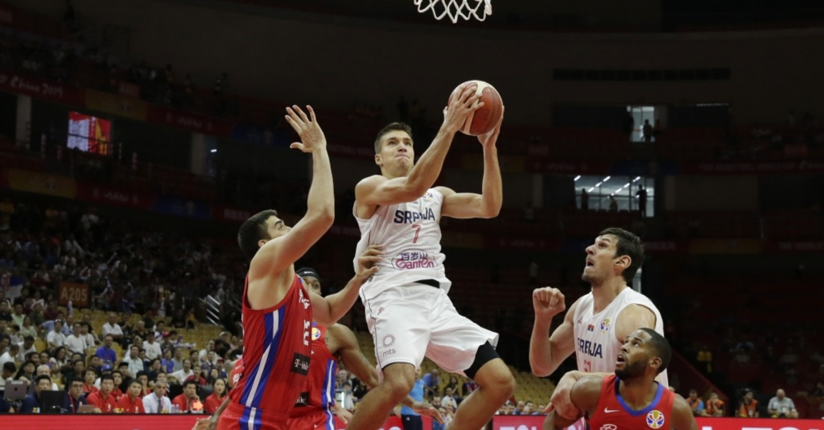 Serbia's Bogdan Bogdanovic in action against Puerto Rico's Jorge Diaz and Gary Browne, Sept. 6, 2019.