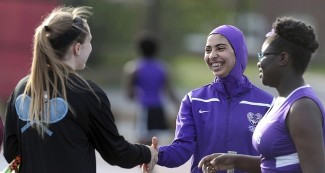 Tabarek Kadhim (C) congratulates an opponent  after a tennis match in Windham, Maine.