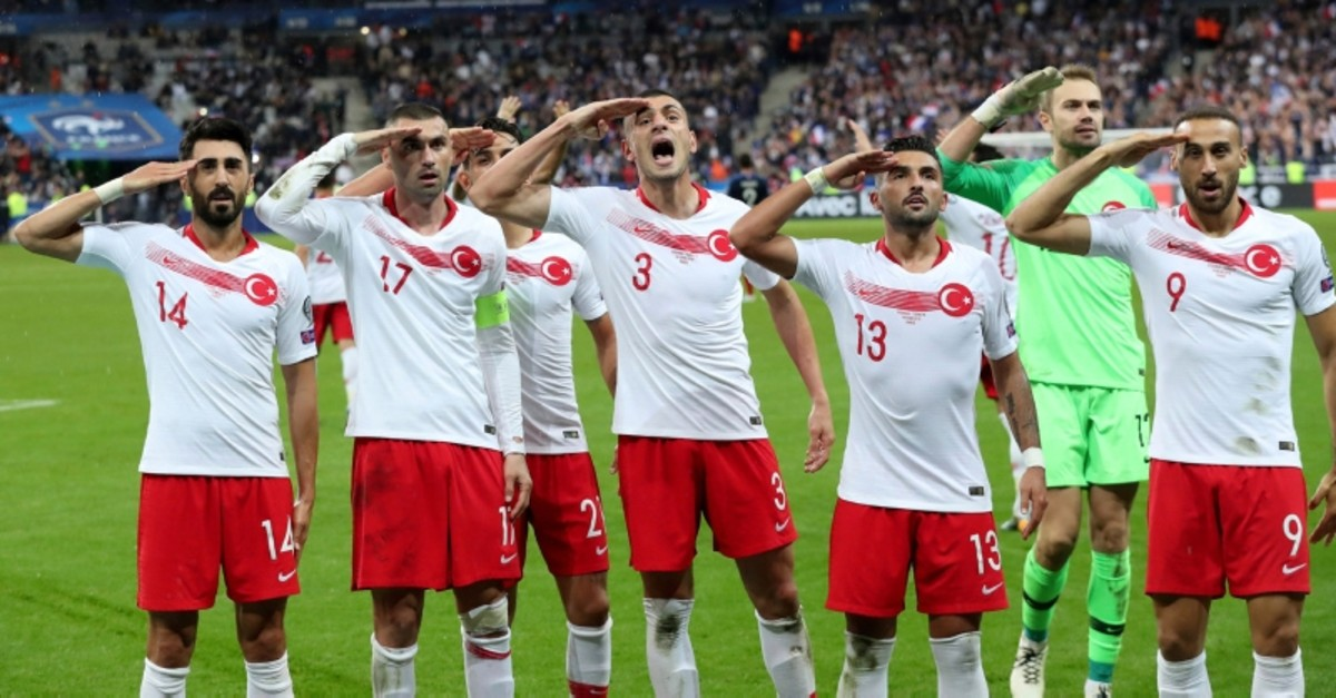 In this Monday, Oct. 14, 2019 file photo, Turkey's players salute as they celebrate a goal against France during the Euro 2020 group H qualifying match between France and Turkey at Stade de France at Saint Denis, north of Paris, France. (AP Photo)