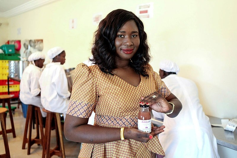Aissata Diakite, agribusiness engineer and founder of Zabbaan Holding juices, poses with a bottle of her natural juices made in Bamako.