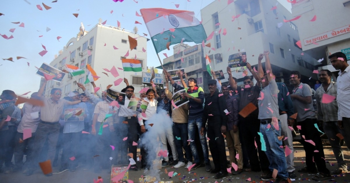 People celebrate before the release of Indian Air Force pilot, who was captured by Pakistan on Wednesday, in a street in Ahmedabad, India, March 1, 2019. (Reuters Photo)