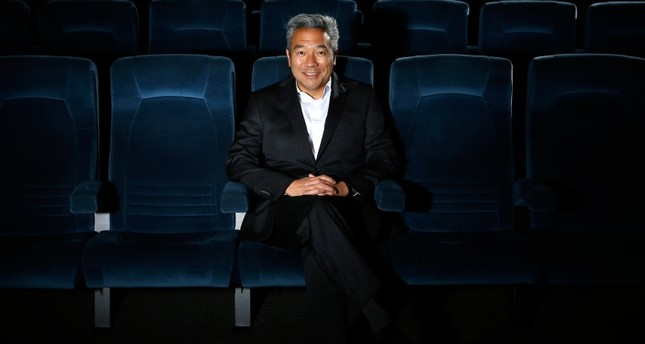 In this Feb. 6, 2013, file photo, Kevin Tsujihara, poses for photos in a screening room at the Warner Bros. Studios in Burbank, Calif. (AP Photo)