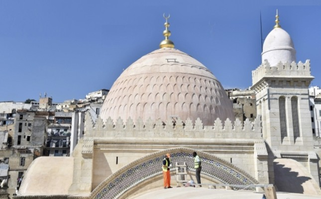 Workers restore part of the roof of Ketchaoua Mosque in the famed UNESCO-listed Casbah district of Algiers as they complete the final stages of its renovation.
