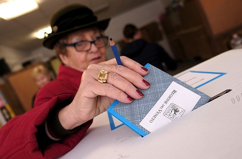 A woman casts her vote for Veneto's autonomy referendum at a polling station in Venice, Italy (Reuters Photo)