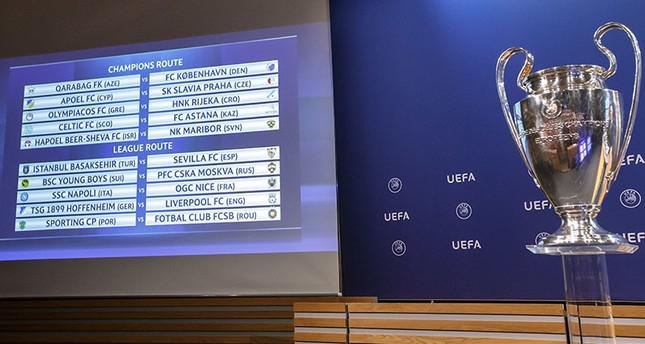 The group formations are shown on an electronic panel next to the Champions League trophy, after the drawing of the games for the Champions League 2017/18 play-off matches at the UEFA headquarters in Nyon, Switzerland, Aug. 4, 2017. (AP Photo)