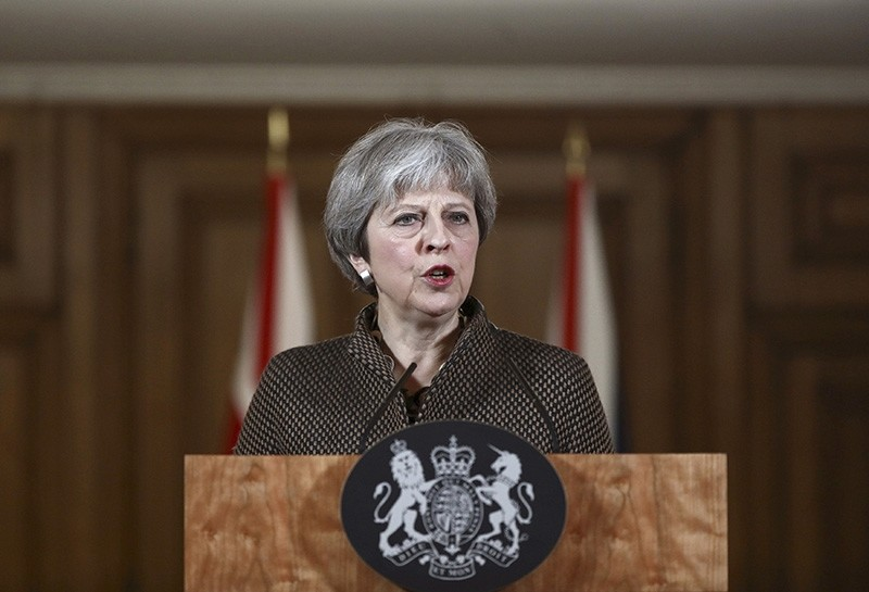 Britain's Prime Minister Theresa May speaks during a press conference at 10 Downing Street in London on the air strikes against Syria, Saturday April 14, 2018. (AP Photo)