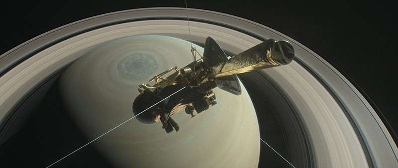An undated handout photo made available by NASA shows an illustration of NASA's Cassini spacecraft above Saturn's northern hemisphere prior to one of its 22 grand finale dives, in Space (reissued 26 April 2017). (EPA Photo)