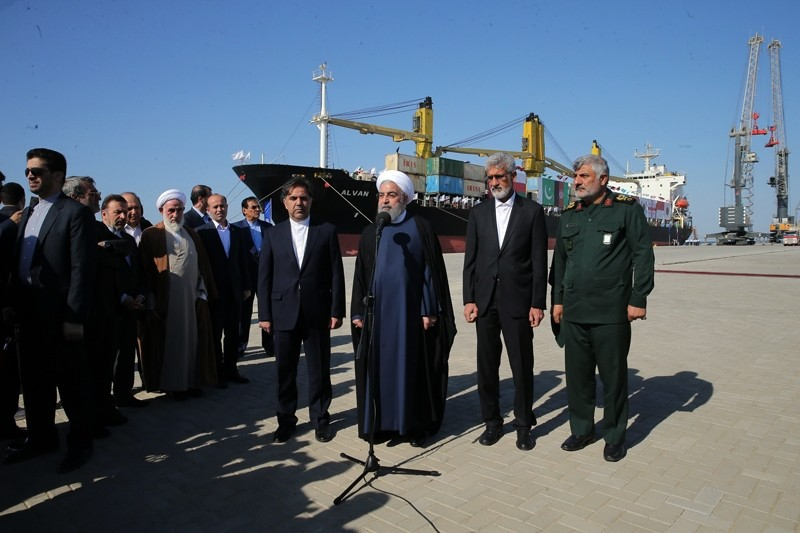 A handout picture provided by the office of Iranian President Hassan Rouhani on December 3, 2017 shows him (C) inauguraiting the first phase of Chabahar (Shahid Beheshti) Port in the southern Iranian coastal city of Chabahar ( AFP Photo)