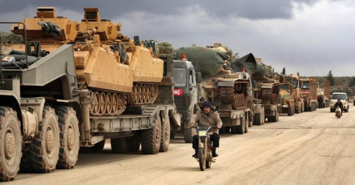 Turkish military convoy drives through the village of Binnish, in Idlib province, Syria, Saturday, Feb. 8, 2020. (AP Photo)
