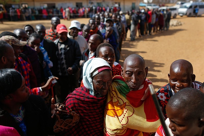 Voters wait in line to cast their votes in general elections at a polling station in Iloodokilani in Kajiado County, some 100km south of the capital Nairobi, Kenya, August 8, 2017. (EPA Photo)