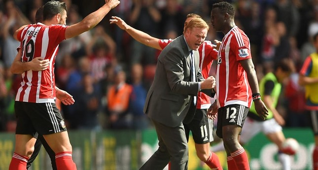 Ronald Koeman joins in the festivities during the English Premier League soccer match between Southampton FC and Crystal Palace at the St Mary's stadium in Southampton , England. Sunday May 15, 2016 (AP Photo)