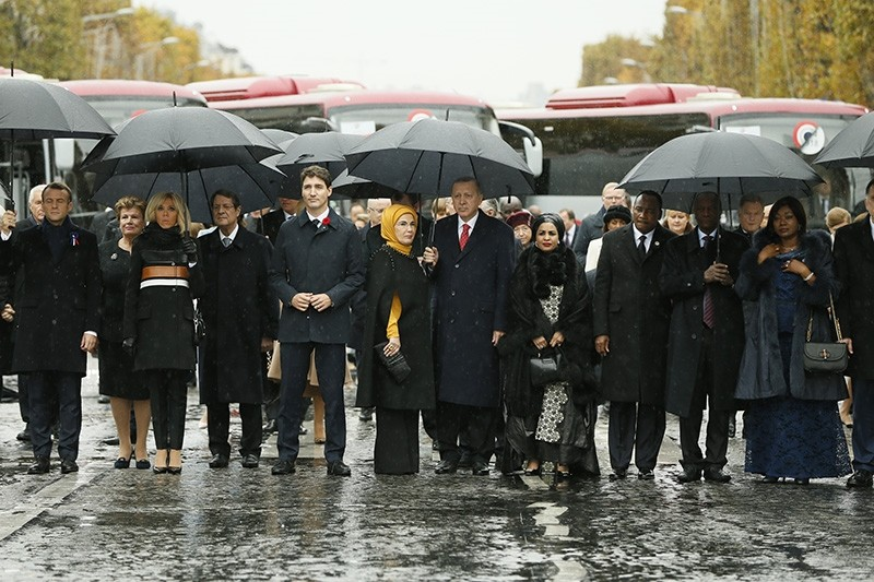President Recep Tayyip Erdou011fan (5th from right) and first lady Emine Erdou011fan (5th from left) join solemn walk down Champs-Elysee marking 100th Armistice Day. (AA Photo)