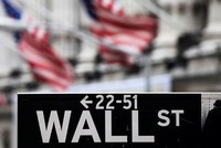 U.S. stocks ticked lower on Wednesday following two sessions of strong gains as upbeat corporate earnings were offset by uncertainty over the feasibility of a proposed business tax cut.