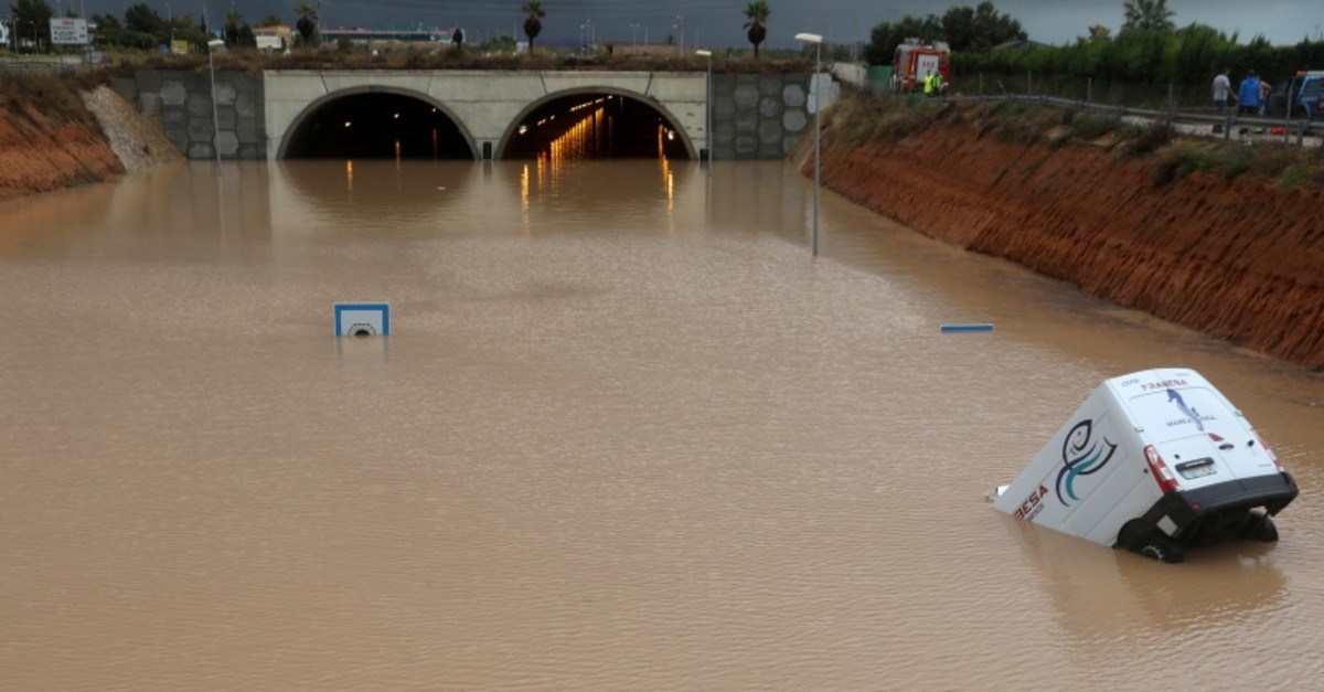 A partially submerged vehicle is pictured near a flooded tunnel after heavy floods in Pilar de la Horadada, Spain, September 13, 2019. (Reuters Photo)