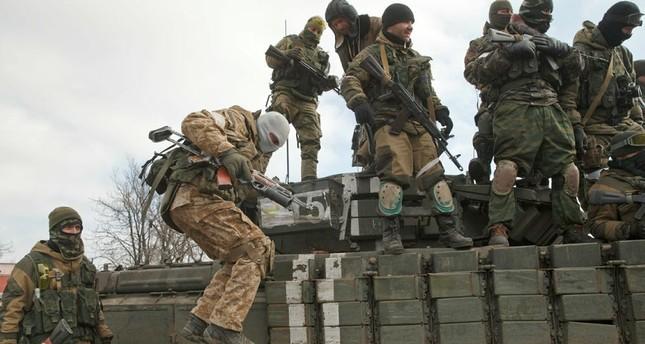 A Russia-backed rebel jumps off a tank in Debaltseve, Ukraine, Friday, Feb. 20, 2015. (AP Photo)