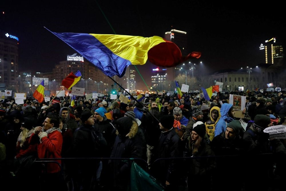 A protester waving a Romanian flag during a protest in Bucharest, Romania, Feb. 2.