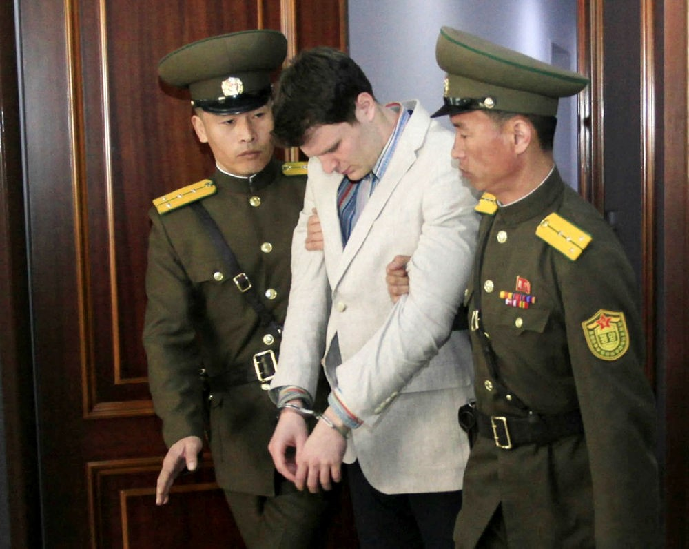 American student Otto Warmbier, center, is escorted at the Supreme Court in Pyongyang, North Korea. (AP Photo)