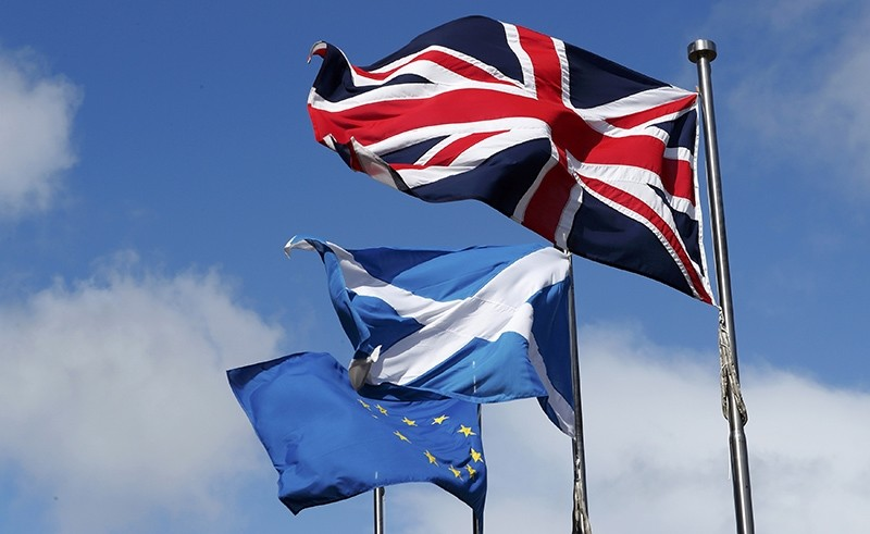 The Union flag,The Scottish Saltire and The European flag fly at the Scottish Parliament in Edinburgh Scotland (Reuters Photo)