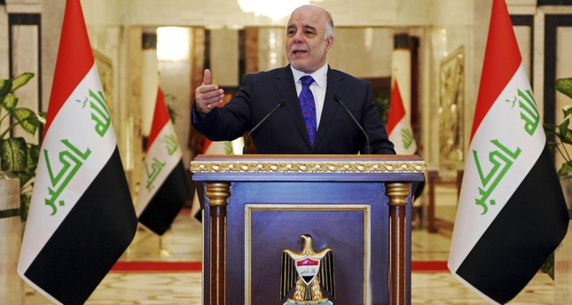 Iraqi premier-designate Haider al-Abadi speaks at his first press conference since accepting the nomination to be Iraq's next prime minister, in Baghdad, Iraq, Aug. 25, 2014. (AP Photo)