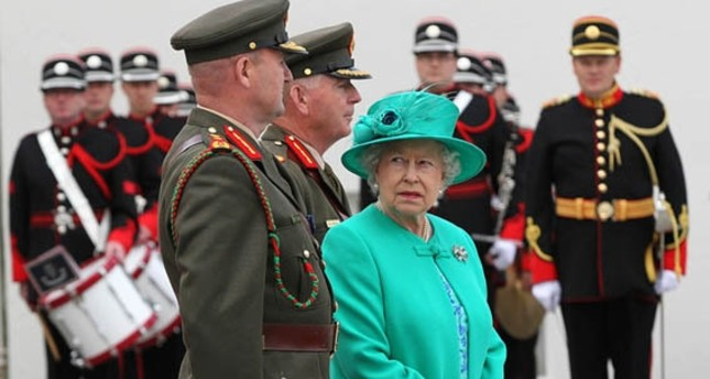 Queen Elizabeth II looks back at Irish Defence Guard Chief of Staff, Lt. Gen. Sean McCann, at the Aras an Uachtarain, in Dublin, 2011.