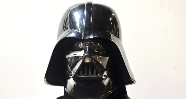 A Darth Vader helmet and mask from the film The Empire Strikes Back on display at the Profiles in History auction house.