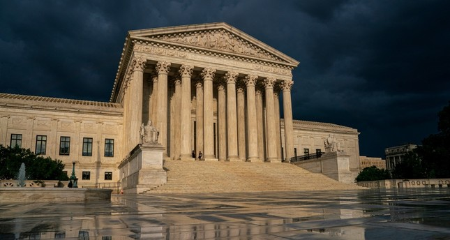 In this June 20, 2019 file photo, the Supreme Court is seen under stormy skies in Washington. (AP Photo)