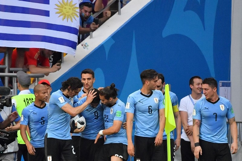 Uruguay nation team players celebrate a goal during the 2018 World Cup Group A football match between Uruguay and Saudi Arabia at the Rostov Arena in Rostov-On-Don, Russia, June 20, 2018. (AFP Photo)