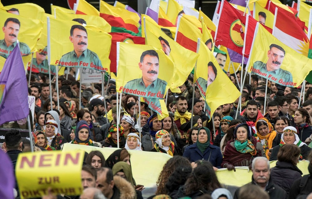 PKK supporters in Germany gather and wave flags with portraits of detained leader Abdullah u00d6calan in Frankfurt, Germany, Saturday, March 18, 2017. (DPA via AP)