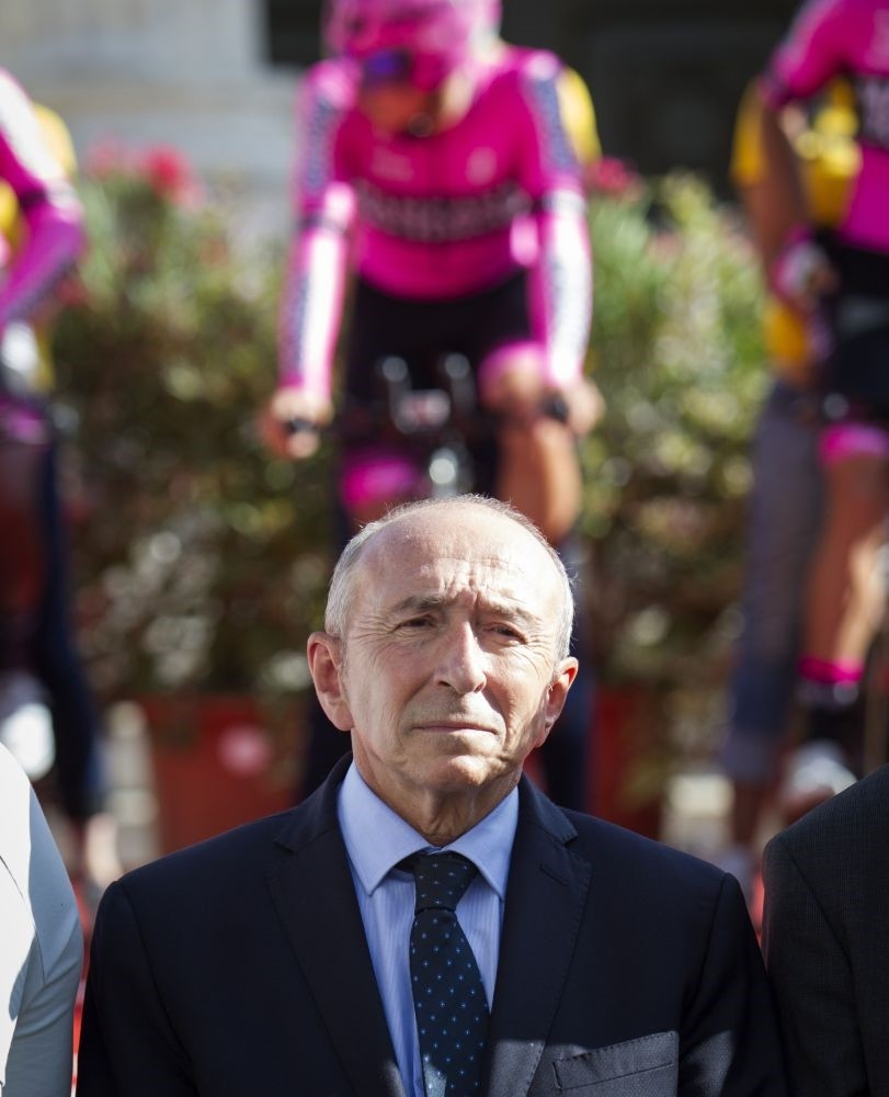 French Minister of Interior Gerard Collomb stands during a minute's silence in solidarity with Barcelona following a vehicle attack on the city.