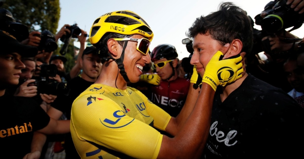 Team INEOS rider Egan Bernal of Colombia, wearing the overall leader's yellow jersey, celebrates after the finish. (Reuters Photo)
