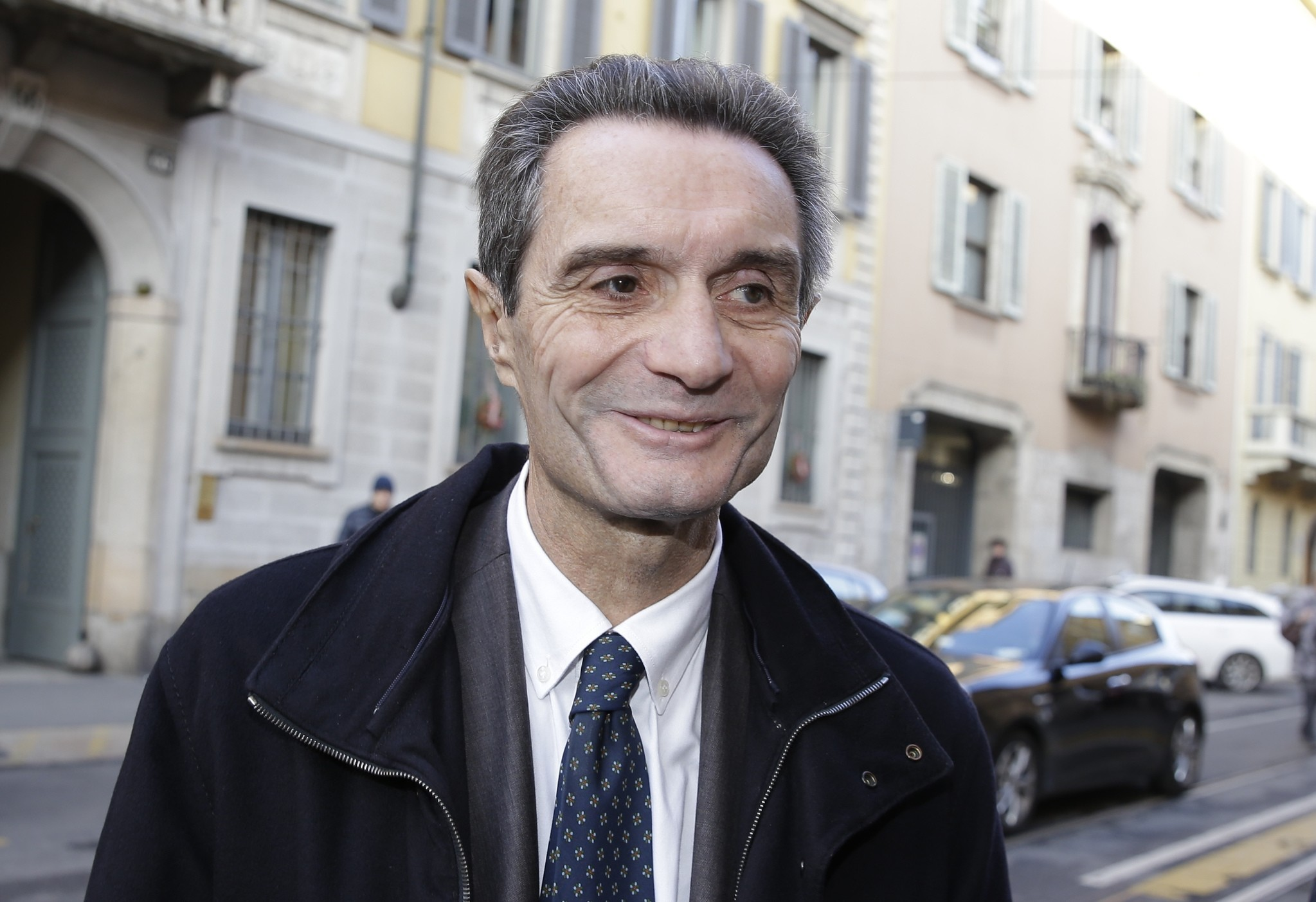 Attilio Fontana arrives for a news conference at the Palazzo ex Stelline, in Milan, Italy. (AP Photo)