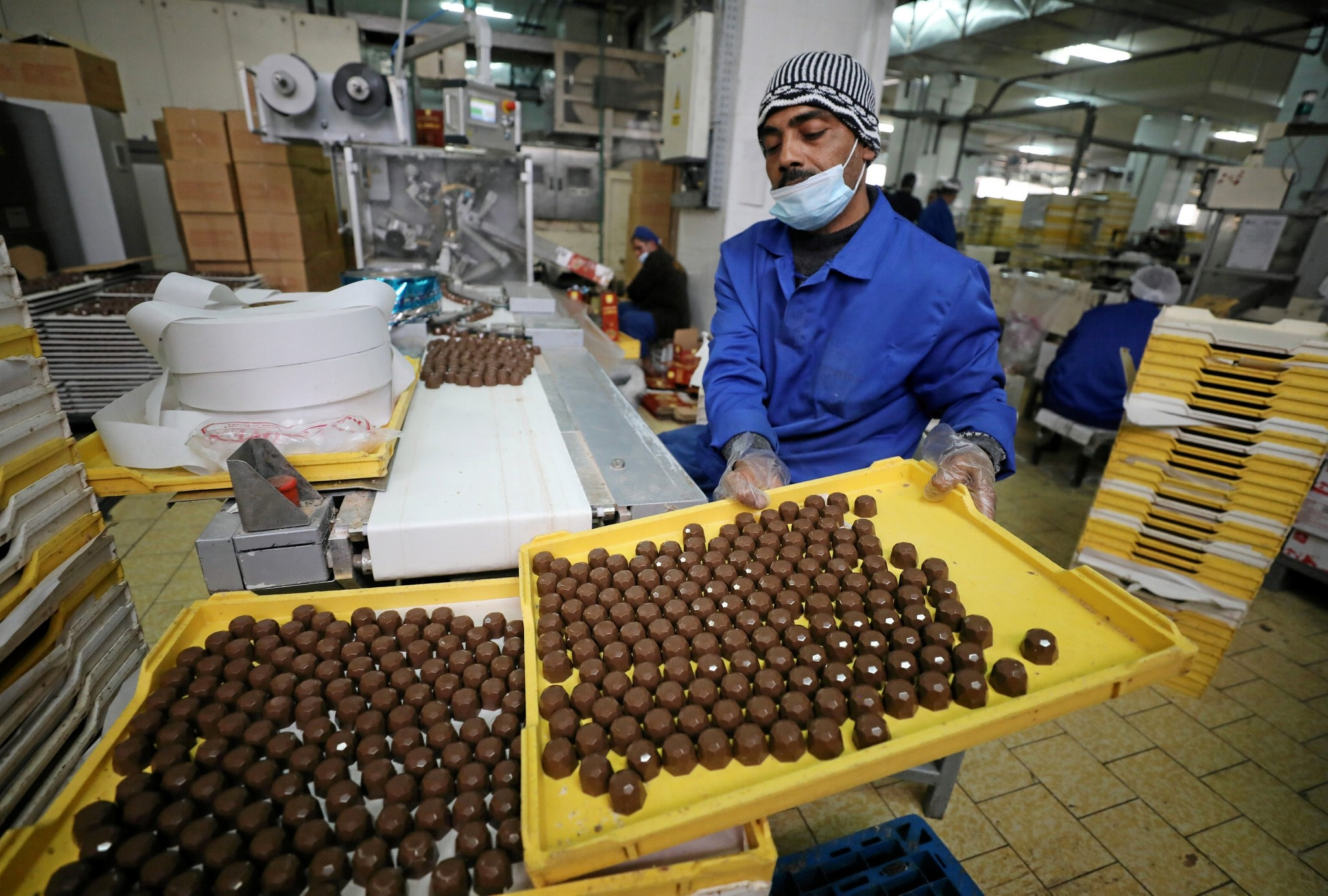 An Egyptian worker works at a local chocolate factory in Cairo.