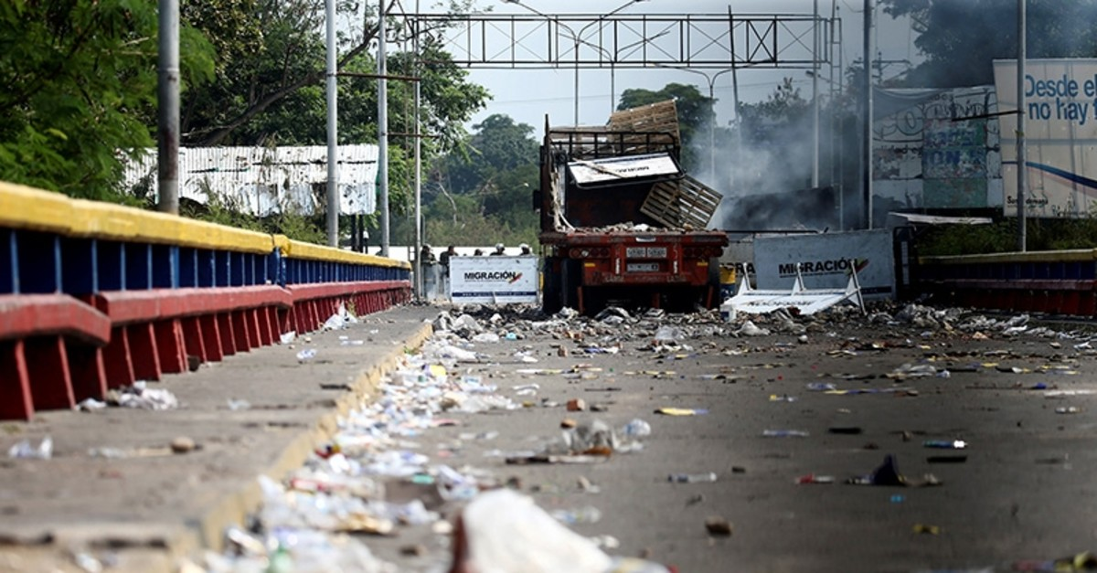 A burnt truck that was used to transport humanitarian aid is seen on the Francisco de Paula Santander cross-border bridge between Colombia and Venezuela in Cucuta, Colombia, on Feb. 24, 2019. (Reuters Photo)