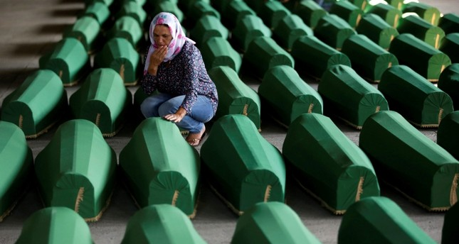 Muslim women cry near coffins of their relatives, who are newly identified victims of the 1995 Srebrenica massacre, which are lined up for a joint burial in Potocari near Srebrenica, Bosnia and Herzegovina July 9, 2016. (Reuters Photo)