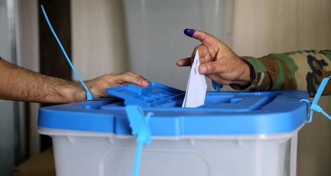 A Kurdish peshmerga soldier votes during the Iraqi Kurdistan independence referendum in Irbil on Sept. 25.