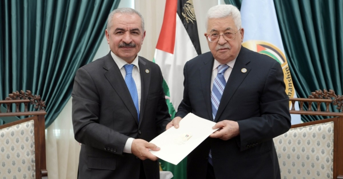 Senior Fatah official Mohammad Shtayyeh receives a designation letter from Palestinian President Mahmoud Abbas to form a new Palestinian government. (Reuters Photo)